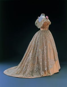 Evening dress,  c.1854  From the Musee du Costume et de la Dentell. Peach silk with gorgeous lace overlay.