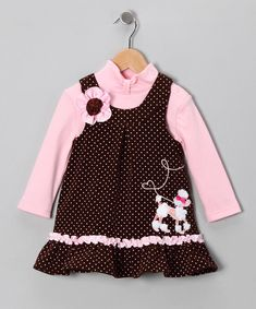 Designed with giggly little girls in mind, this corduroy jumper features a sparkling furry friend appliqué plus ruffles, polka dots and a flower detail. Back buttons make it easy to layer over the soft, stretchy bodysuit for a picture-perfect ensemble.Note: Infant sizes include bodysuit and jumper. Toddler and girl sizes include turtleneck and jumper.