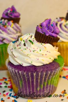 Mardi Gras Cupcakes with Cinnamon Cream Cheese Frosting. Love the mini on top!