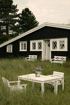 so nice, black and white summer house. Photograph: Stuart McIntyre
