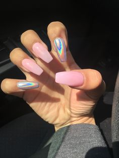 Pink and holographic nails.