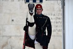 A Greek Evzone, guardian of the Tomb of the Unknown Soldier, displaying his impressive anti-aircraft capabilities. My Athens, Athens Greece, Unknown Soldier, Greek House, Betty White, Houses Of Parliament, Love Photography, High Quality Images