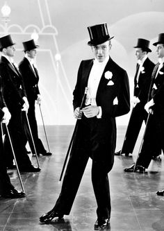 Top Hat (1935)     even his speech had the style and rythm of his softly staccato taps...i'm puttin' on my top hat....tyin' up my white tie.....brushin' off my tails !