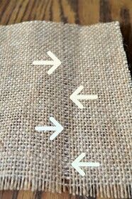 How to cut burlap.  Pull 1 or 2 strings out where you want to cut.   Perfect even cut!