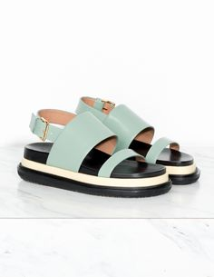 Marni Vitello Fussbett Sandal Two-band fussbett with sling-back strap with metal buckle, on the toe band, thick band across vamp, molded black and white leather footbed, and a black rubber sole. Color