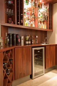 BAR BY JOOS  The ultimate boy's toy, this wooden bar unit comes complete with built-in wine racks. http://joos.co.za/custom-bar/