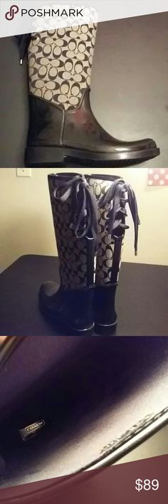 Coach 'Tristee' Rainboots Authentic Excellent used condition, only wore a few times. Cream and Black Signature C rainboots with laces up back, can also accomodate a wide calf. Are a true size 11, but could also accomodate a size 10. Coach Shoes Winter & Rain Boots