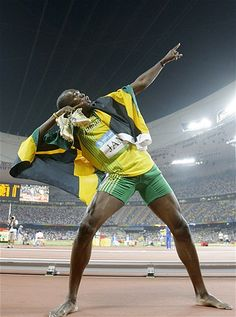 Jamaica's Usain Bolt celebrates winning his third gold medal after the final for the men's 4x100-meter relay during the athletics competitions in the National Stadium at the Beijing 2008 Olympics. (Greg Baker/AP Photo)