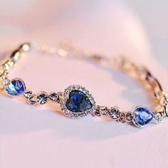 Exquisite Blue Color Heart Shaped Womens Crystal Bracelet With Gold... ($50) ❤ liked on Polyvore featuring jewelry, bracelets, gold plated bangles, blue crystal jewelry, heart shaped jewelry, crystal jewelry and blue jewelry