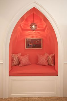 Beautiful lines, the lantern, the moulding & trim, the pillows... little nook in basement under-stairs closet?