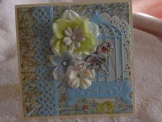 Birdcage, flowers, doily, lattice border and bird with flowers handmade card