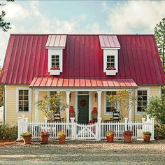 cute little cottage. Love it!!! I really like the paint color too!!!
