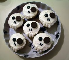 skeleton cupcakes - I made these once, I wish I remembered where I got the directions.  I know I used M for one eye, and I think it was either mini PB cups (bottoms) or Junior Mints for the other eye? Tic tacs worked for the teeth since I couldn't find white jelly beans.  Noes was shoestring licorice I believe.