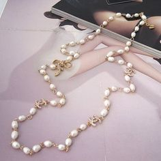 Chanel white pearl necklace. One day I must have this!