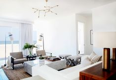 The Emerging Design Trends You Need to Know About// Airy beach house design with marble coffee table