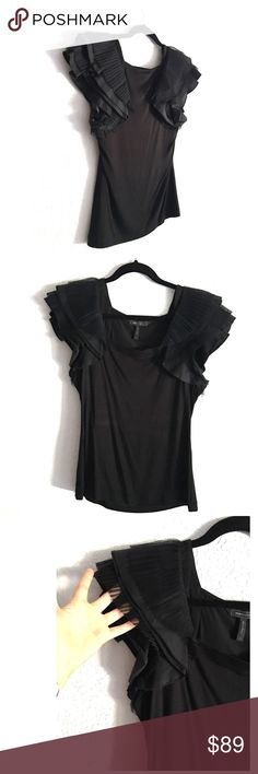 ✨Bcbg Max Azria Super Chic & Elegant Top!✨ Very elegant black Jersey top with glamour layered sleeves! Delicate ruffle details on sleeves! VERY Excellent condition! THIS ONE IS MY FAV! Dress it up/down. It would be really cute with a mini Kensie skirt that I have in my closet BCBGMaxAzria Tops