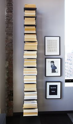Writer Michael Cunningham created a tower of books, spines to the wall, using Conceal Book Shelves by Umbra.
