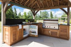 Outdoor BBQ kitchen with Wolf range cooker - Orchard House - Humphrey Munson