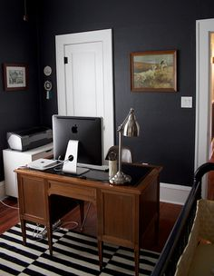 office from lauren bradshaw's 'sneak peek'...love the black walls and rug (loved this ikea rug so much after seeing it online so many times that it now graces our living room)