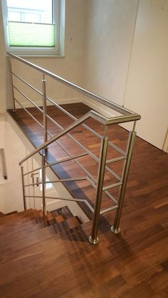 Elegant stainless steel railing made of round tube. Steel Railing Design, Staircase Railing Design, Interior Stair Railing, Modern Stair Railing, Glass Stairs Design, Home Stairs Design, Balcony Grill Design, Balcony Railing Design, Stainless Steel Stair Railing