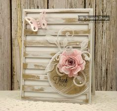 handmade card with The Scalloped Edge rolled dimensional flower in pale pinks ... shabby look with whitewash style inking on kraft ... luv the background die cut of open slats ... great card!