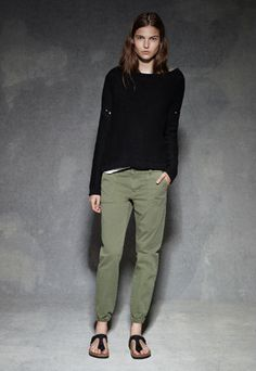 Slouchy sweater, army green pants, black Birkenstocks.