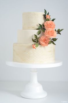 Cream honeycomb cake with peach roses. Baked by @tbakesatelier #weddingcakes