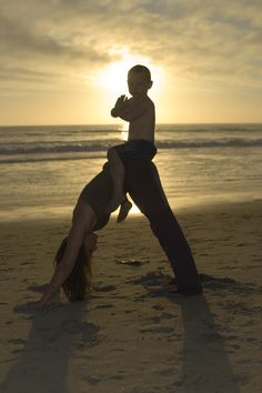 Who said exercising with children is impossible?! #yoga #beach