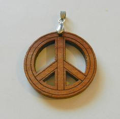 Wooden Peace Sign Charm by CloudNineSupplyShop on Etsy, $4.00