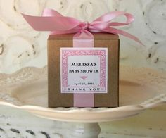 Sandra @ ribbonsandfavors.com  Baby girl? This natural kraft favor box with a pink satin ribbon trim looks beautiful together, tie it up with a simple shoe lace style bow as in the photo and you could be good to go . You can also add a computer generated label as this clever person did.