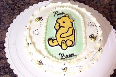 Classic Winnie the Pooh - Practice cake. Never done bees and wasnt sure about a color pallet. This is what I came up with Classic Winnie the Pooh design. Strawberry cake, buttercream icing, vanilla custard filling BCT. First attempt on bees. Those little things were fun to do!