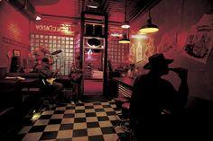 Smoke Daddy blues bar, Jimmy Lee Robinson foreground, Chicago, 1997. William Allard