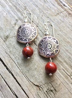 Southwestern pattern silver earrings with a small red jasper dangle. Approx 1.5 in length and very light weight.