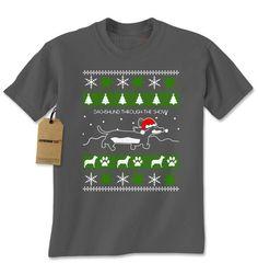 Dachshund Puppy Dog Dashing Through a Christmas Scene. Dachshund Through The Snow Ugly Christmas Mens t-shirt! #tshirt #tshirts #printedtshirts #graphictshirts #cooltshirts  #expressiontshirts #customteeshirts #tshirtsonline #christmastshirts  http://teehunter.com/