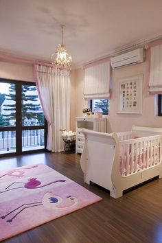 Girls baby room, wood floors, pink and white accesories
