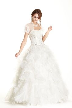 Floor Length A-Line Prom and Evening Dress has Detail Embroidered and Gemstone Embellished Corset Bodice with Sweetheart and Strapless Neckline and Low Back with Lace-up Closure, Long Ruffle Skirt Completes the Style.
