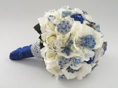 Jeweled Bridal Bouquet with Blue Brooches, Medium. $245.00, via Etsy... I LOVE the look of using mostly silk flowers, and highlighting with brooches.  This could be much easier and cheaper to make myself! :-)