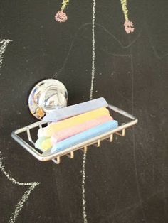 Use a suction cup soap holder to hold chalk, whiteboard markers, etc...great idea for home or classroom:)