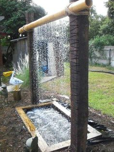 DIY Garden Waterfalls - Jane Redmond - - DIY Garden Waterfalls Take a stick of bamboo, hang it between two logs (or other bamboo sticks!), work some pipe magic, and get a great looking waterfall for your garden.