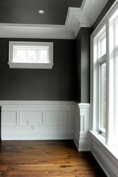 That is some badass white crown molding. And charcoal gray rooms are the greatest.