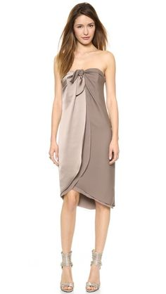 Halston Heritage Strapless Wrap Dress in Taupe $375 -   An elegant Halston Heritage dress composed of panels of lustrous satin and tactile crepe. A built-in bra and flexible boning structure the strapless bodice, and sheer georgette lining peeks from the curved hem.