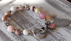 This beautiful victorian chunky beaded bracelet has an assortment of beads in prettypinks, pearls, Czech glass, rhinestones, handmade beads and more. The closure is an ov... #bracelets