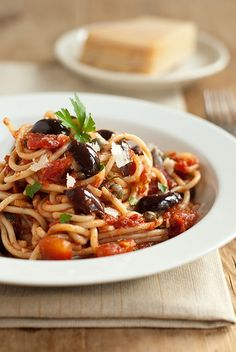 Spaghetti Puttanesca400g spaghetti 2 tbsp olive oil 4 garlic cloves, chopped 1 tbsp anchovies, drained and finely chopped 1/4 tsp red pepper flakes 800g chopped tomatoes (2 cans) 1 tbsp brown sugar 2 tsp balsamic vinegar 3 tbsp kalamata olives, halved 2 tbsp capers, drained, chopped if large 1 tsp oregano 3 tbsp fresh parsley, roughly chopped parmesan cheese, to serve
