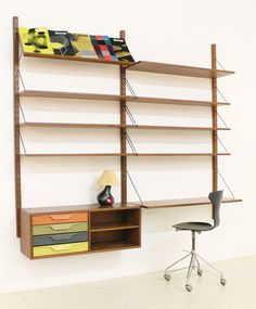 Danish coloured shelving system produced in 1950's by Albert Hansen. Teak wood, brass fittings and coloured metal drawers. Excellent condition.