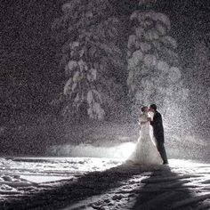 My winter wedding made TheKnot.com! As the night went on, the snow started falling heavier. Our AMAZING photographer (Ciprian Photography...he'll travel anywhere) pulled us outside and back-lit this shot with a powerful flash to get the amazing image you see. Everyone thought he did a granulated effect on the image, but this is all natural...snow. Couldn't have asked for a more memorable image for my big day and people still go on and on about it.