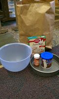Main Idea and Supporting Details Fun Activity  Five items in a bag.  Main idea is baking a cake, details are the items and topic is cakes.