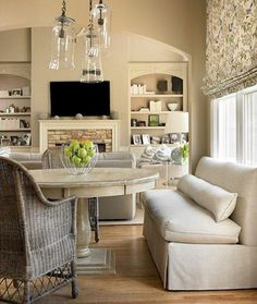 Idea of how to combine my living room and dining area.  Love the pendants, the built ins and the fireplace