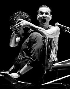 Dave Gahan of Depeche Mode messing with Peter Gordeno on stage