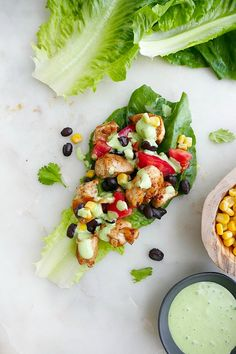 Southwest Healthy Chicken Lettuce Wraps - this easy gluten free and low carb dinner recipe is bursting with flavor from spicy chicken, black beans, tomatoes, corn, and a Greek yogurt jalapeno sauce. Summer Vegetable Recipes, Healthy Vegetable Recipes, Healthy Chicken, Summer Recipes, Healthy Food, Easy Chicken Lettuce Wraps, Mexican Vegetables, Lettuce Recipes, Rotisserie Chicken Salad