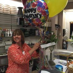 Our fearless leader Georgianne wrapping up a corporate gift! #florist #plant #moneytree #gift #balloons #mmflowers